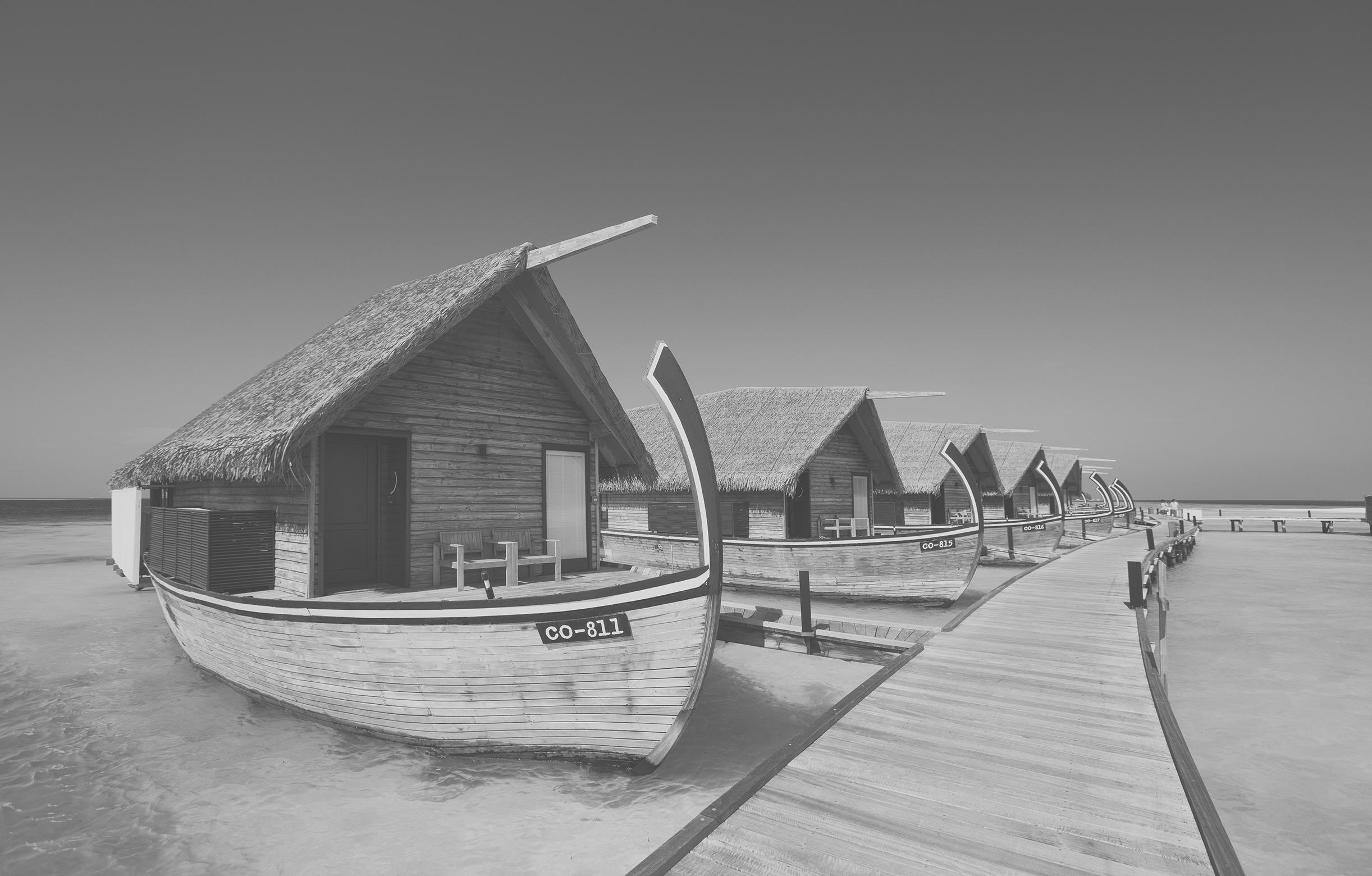 Wasservillen in Form eines Dhonis im COMO Cocoa Island